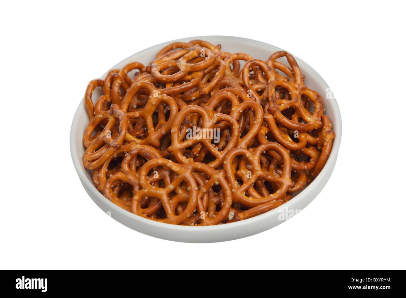 Pretzels in bowl on white background - Stock Image
