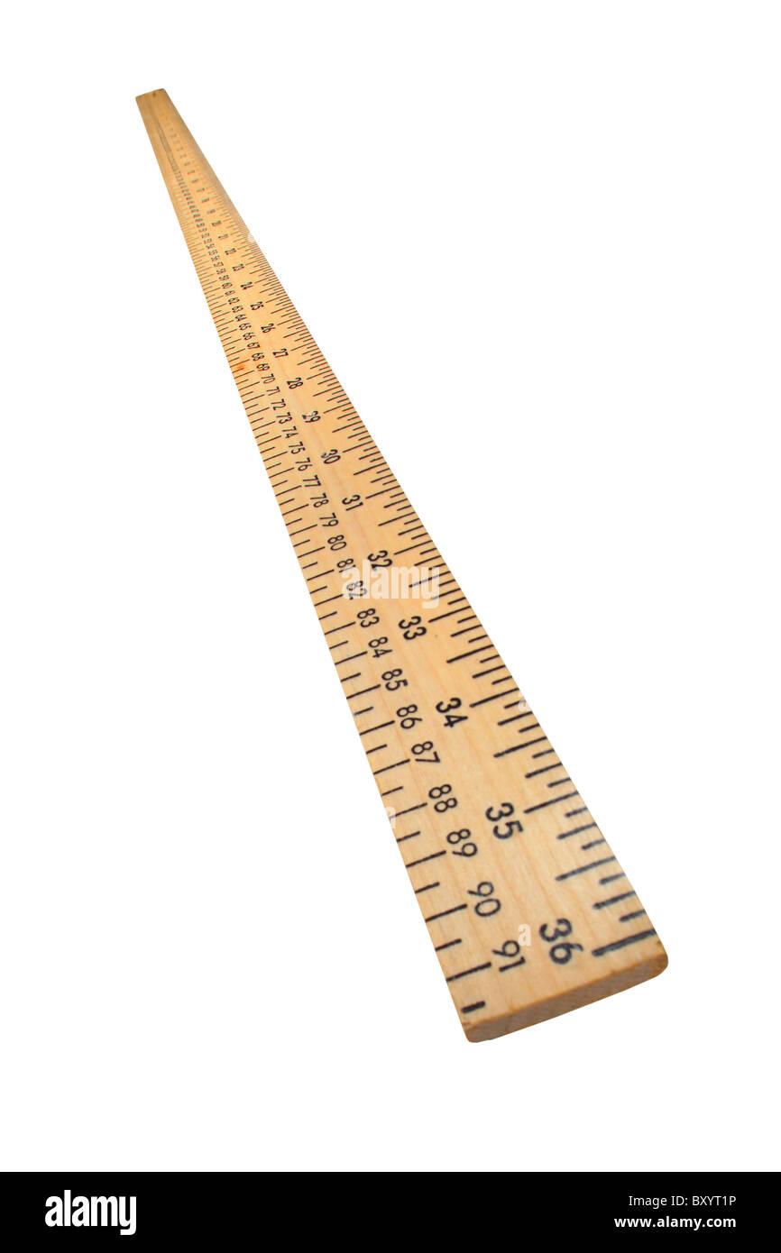 Wooden yard stick on white background - Stock Image