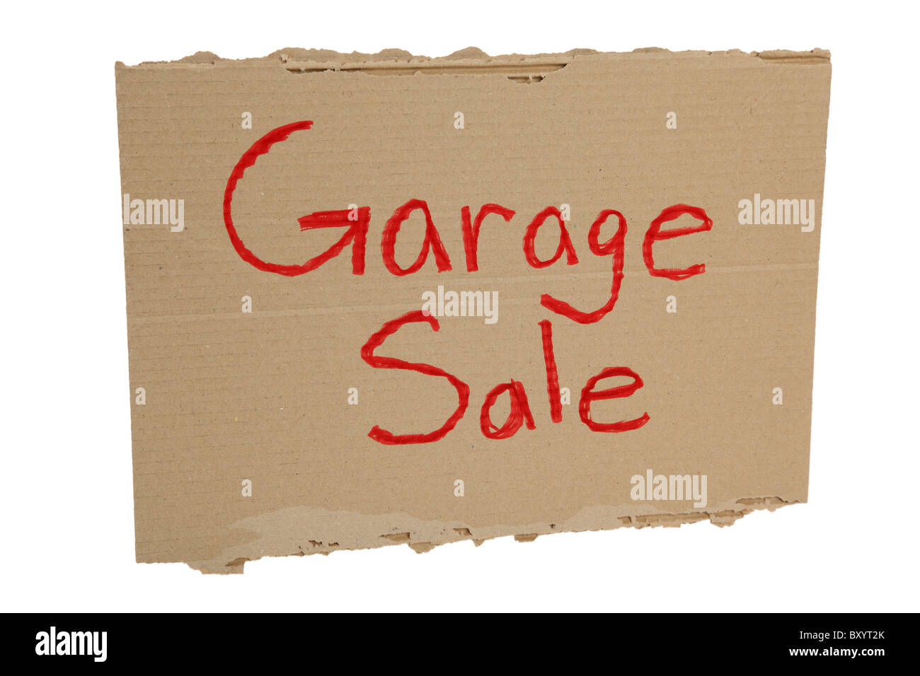 Cardboard Garage Sale sign on white background - Stock Image