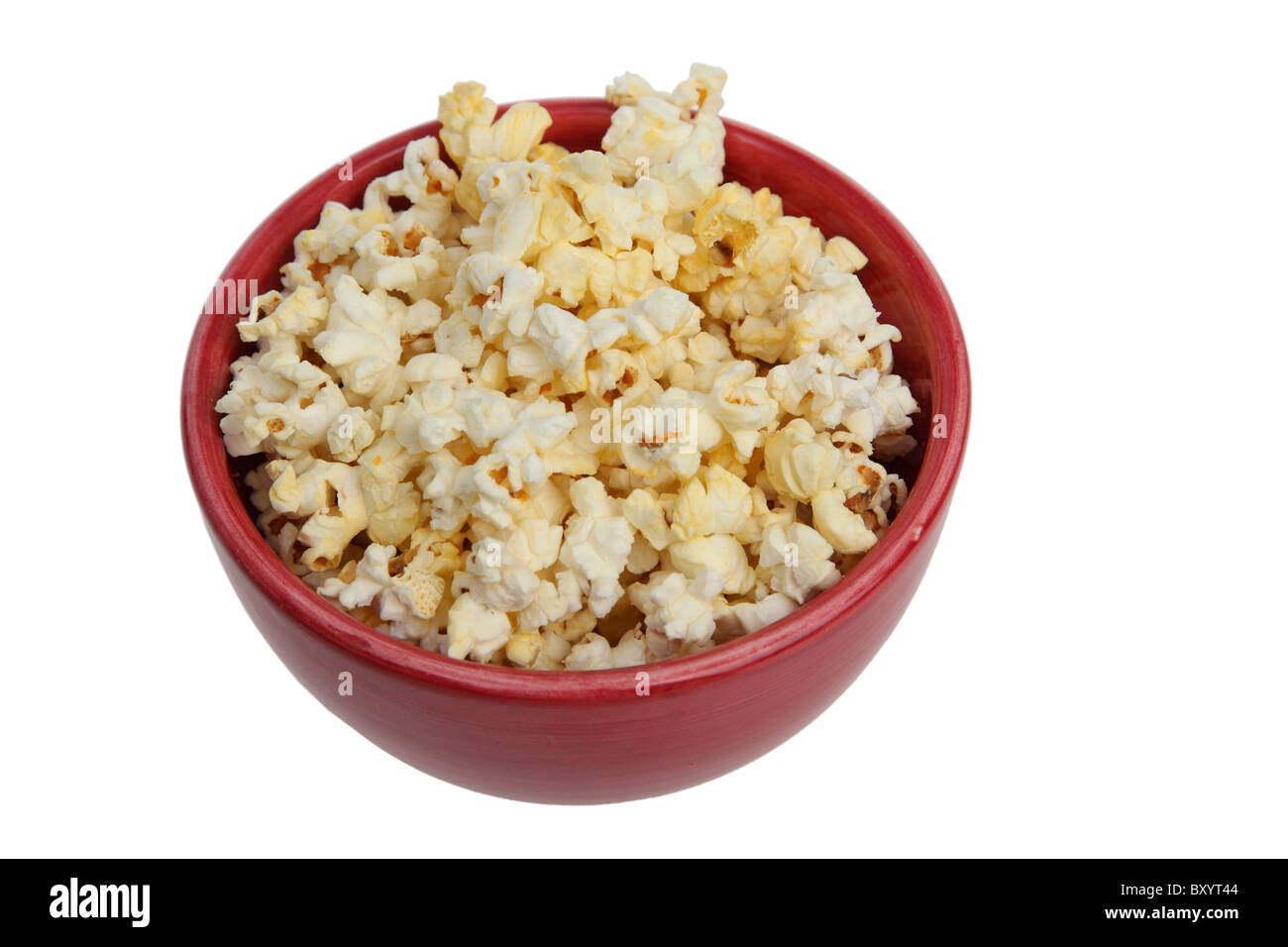 Popcorn in bowl on white background - Stock Image