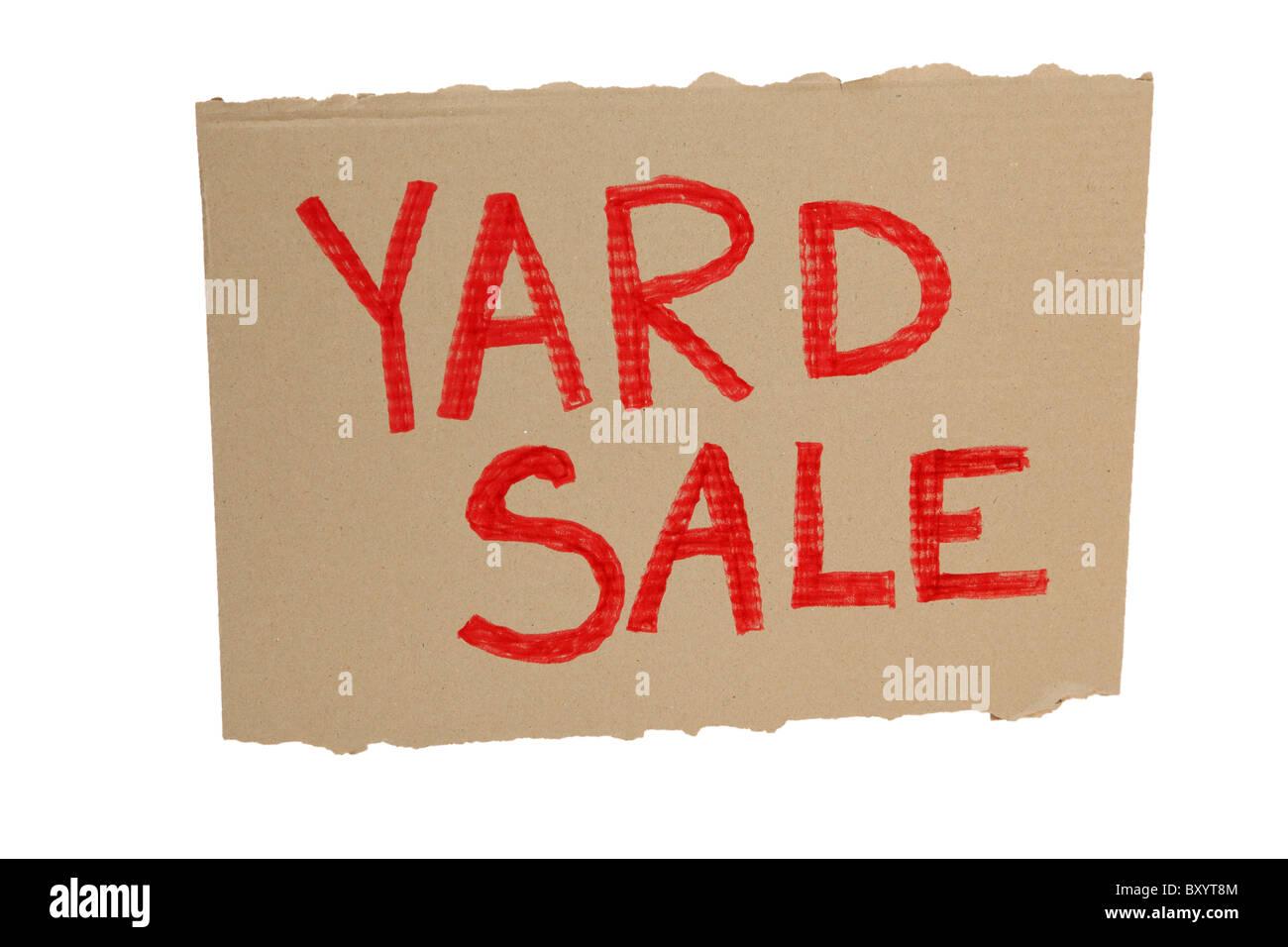 Cardboard yard sale sign on white background - Stock Image
