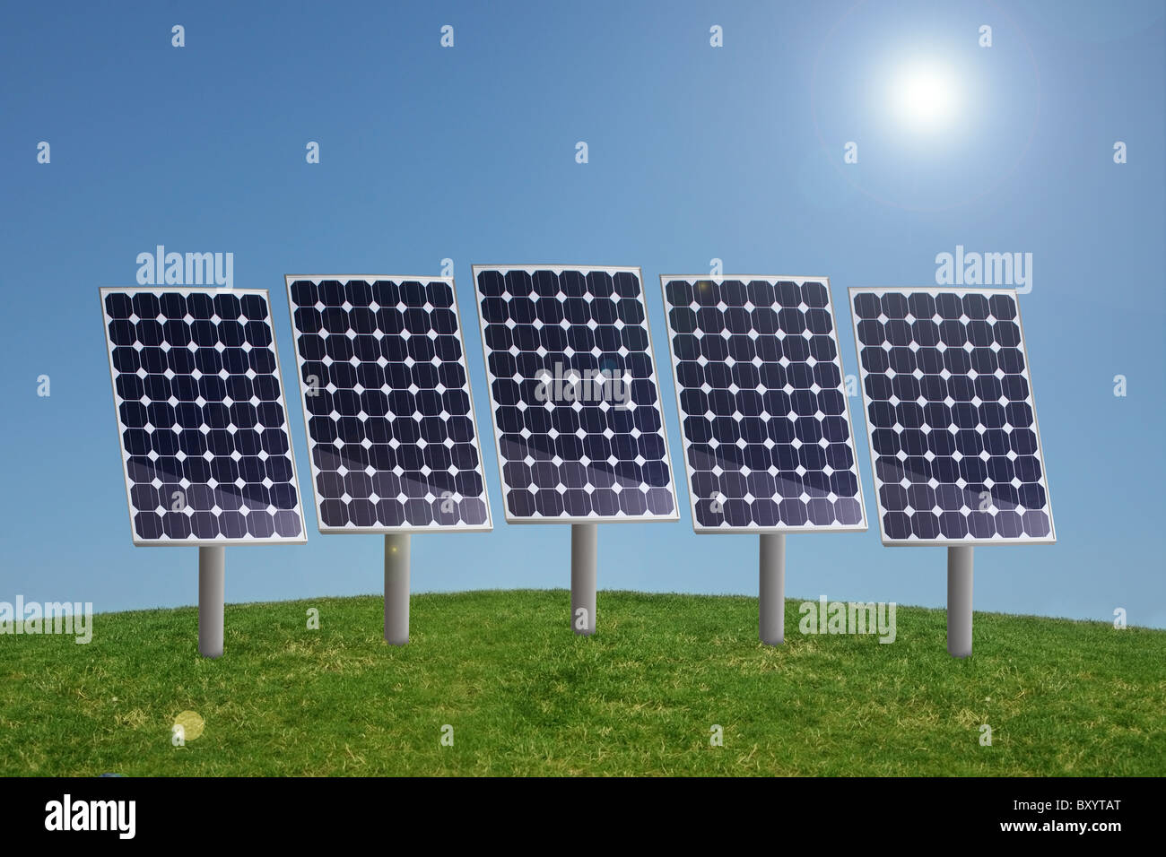 Row of solar panels in grass with blue sky and sun - Stock Image