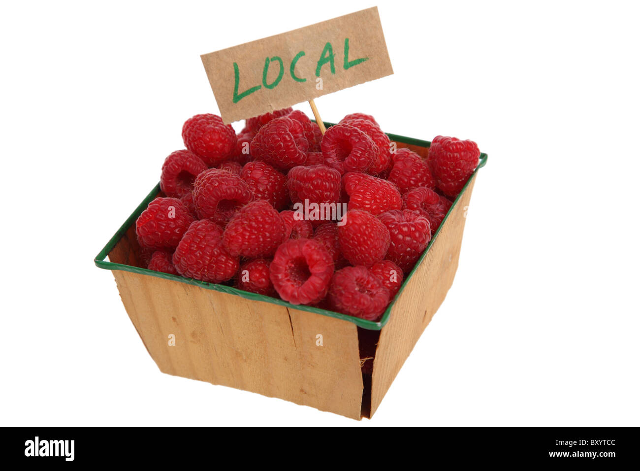 Raspberries with 'LOCAL' sign on white background - Stock Image