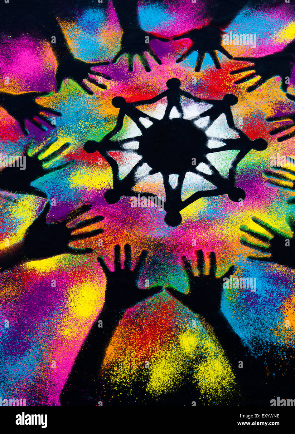 One world unity symbol surrounded by childrens hand prints made with multicoloured powder Stock Photo
