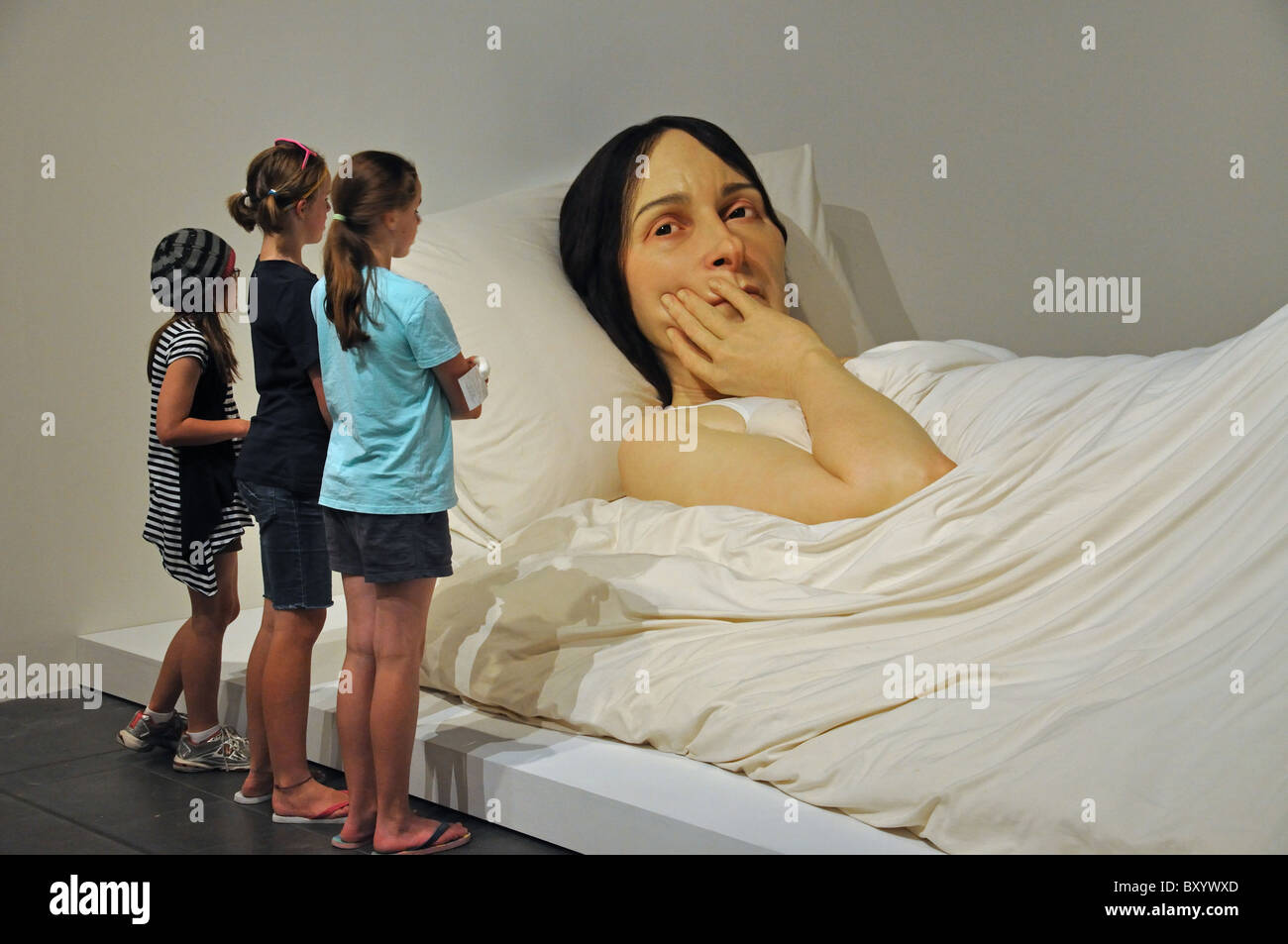 woman in bed sculpture at ron mueck exhibition christchurch art
