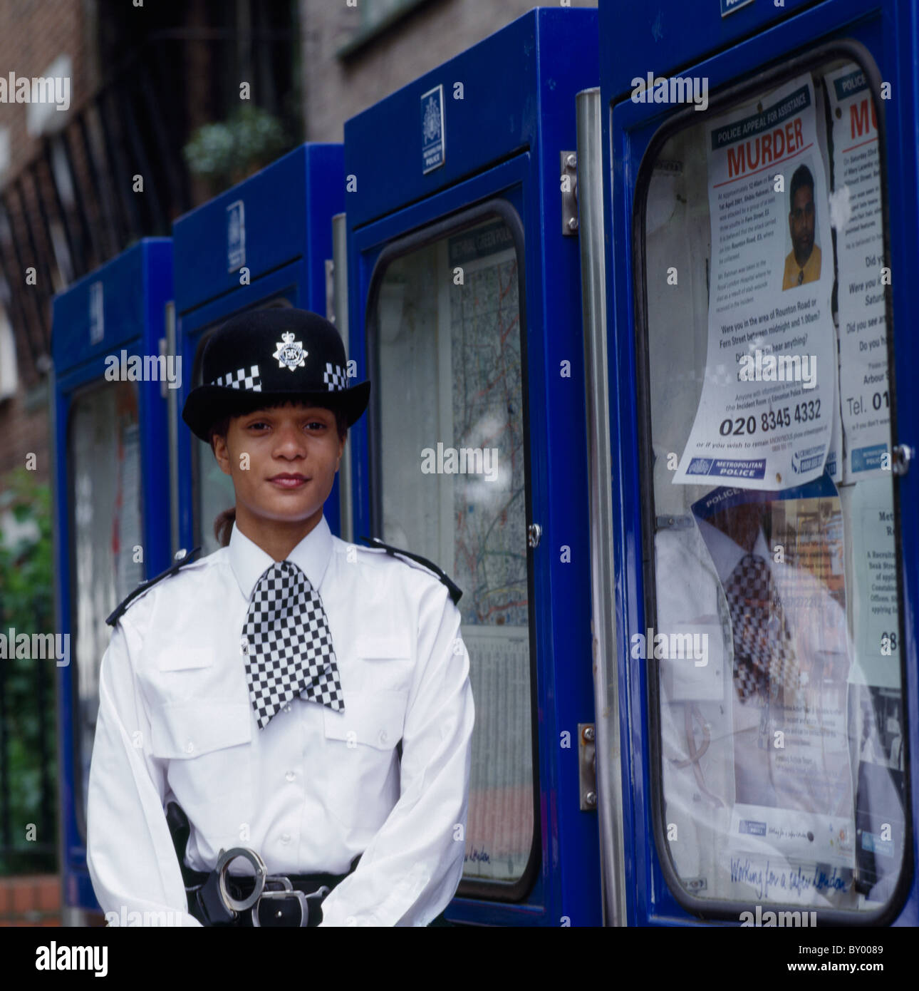Female Metropolitan Police Officer in London in England in Great Britain in the United Kingdom UK. Occupation Work - Stock Image
