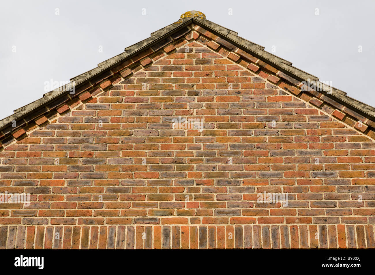 The Gable End Of A House Roof Showing Brick Decorative