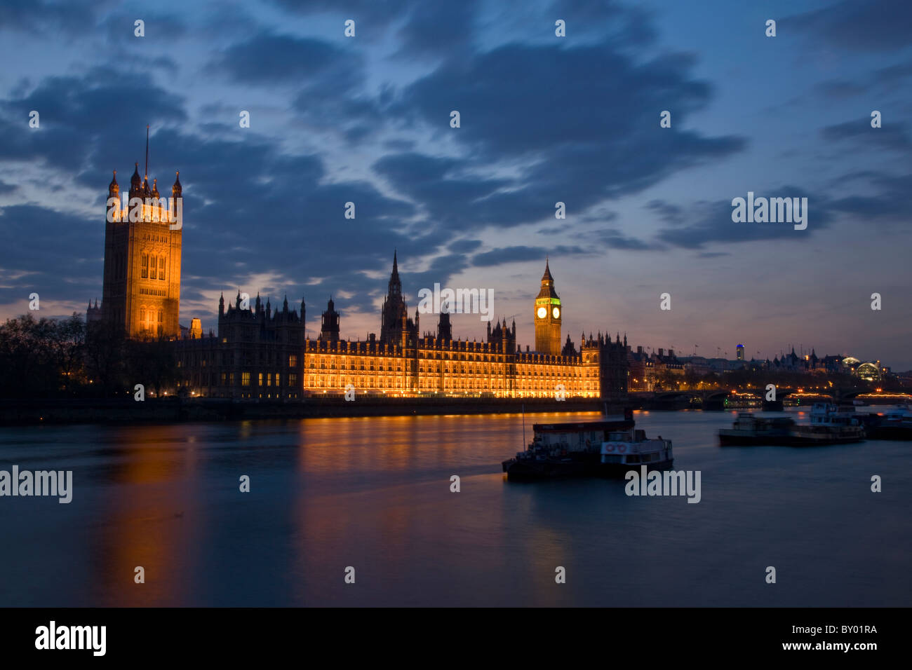 Houses of Parliament viewed from the South Bank at night - Stock Image
