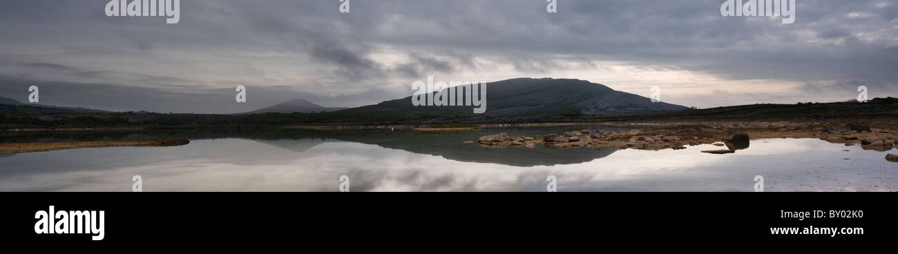 Panoramic view of Mullaghmore mountain in the early morning, from Gortlecka, the Burren, Co Clare, Ireland - Stock Image