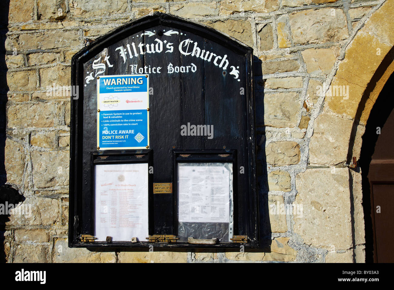 Warning Sign to Thieves on the noticeboard of St Illtud's Church, Llantwit Major, Glamorgan, South Wales, UK - Stock Image