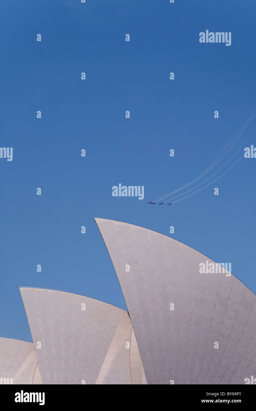 blue sky over sydney opera house roof with planes aerobatic display - Stock Image