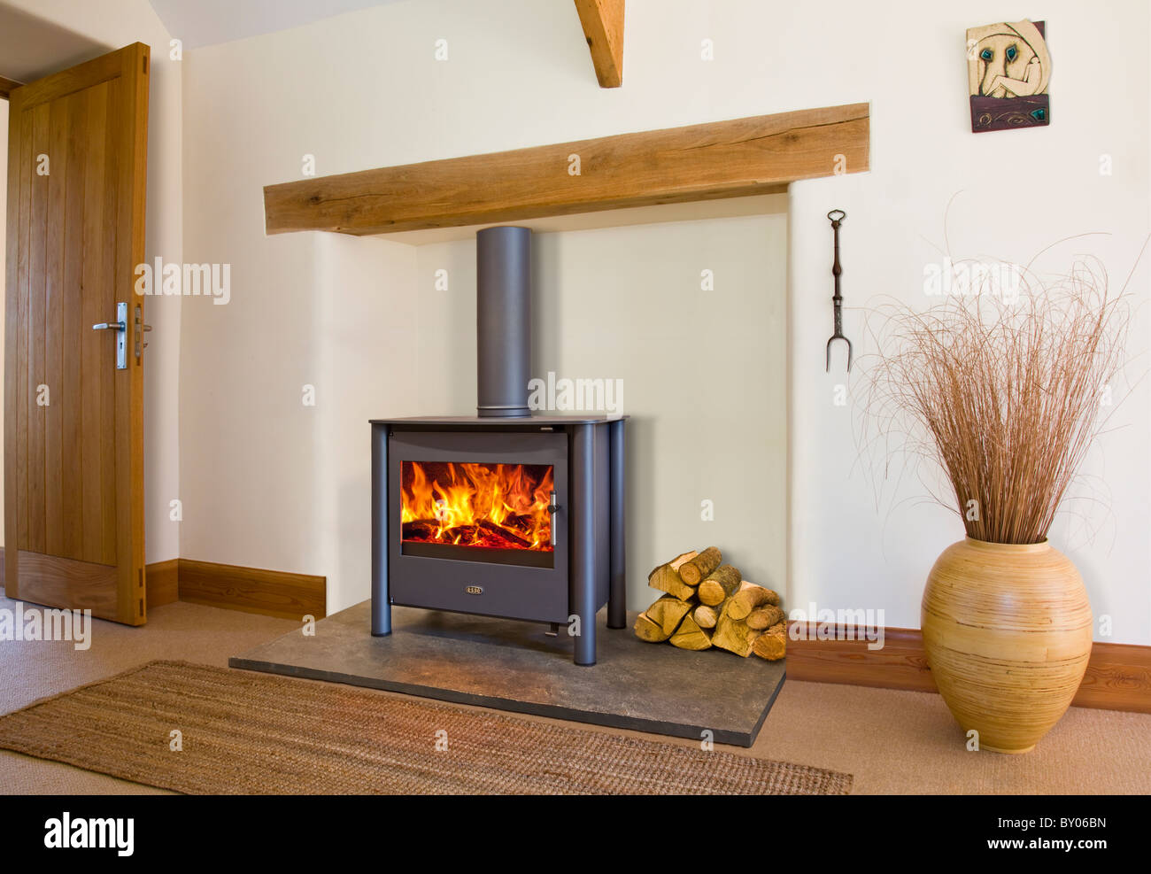 An Esse wood burning stove in a contemporary setting - Stock Image