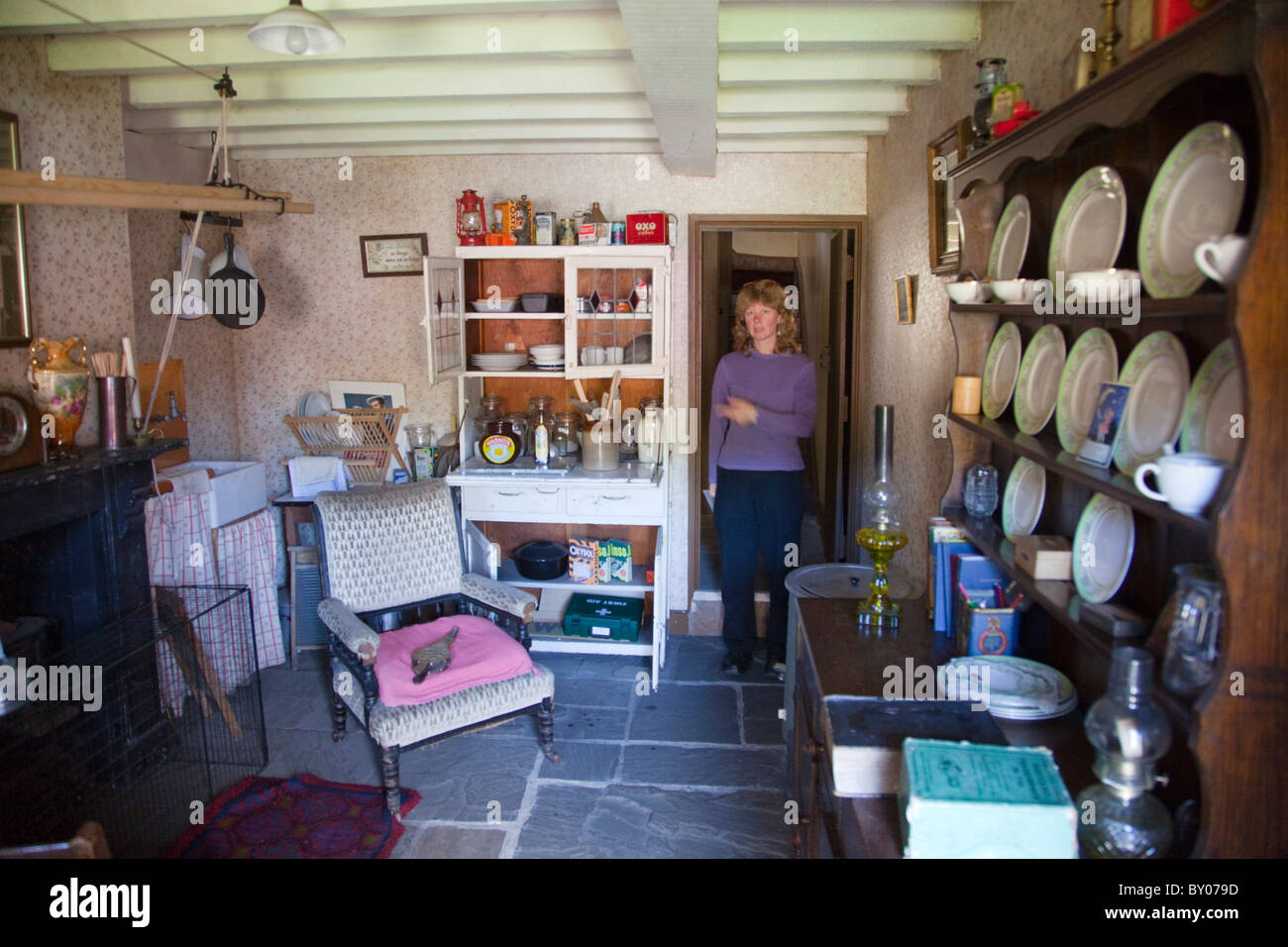 Blaenavon Ironworks Worker's house; visitor to interior; Wales Stock Photo