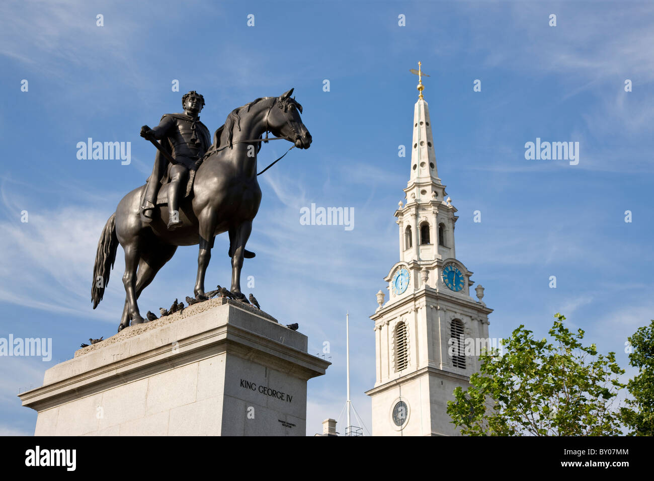 King George IV statue at Trafalgar Square with St Martin in the Fields Church in background - Stock Image