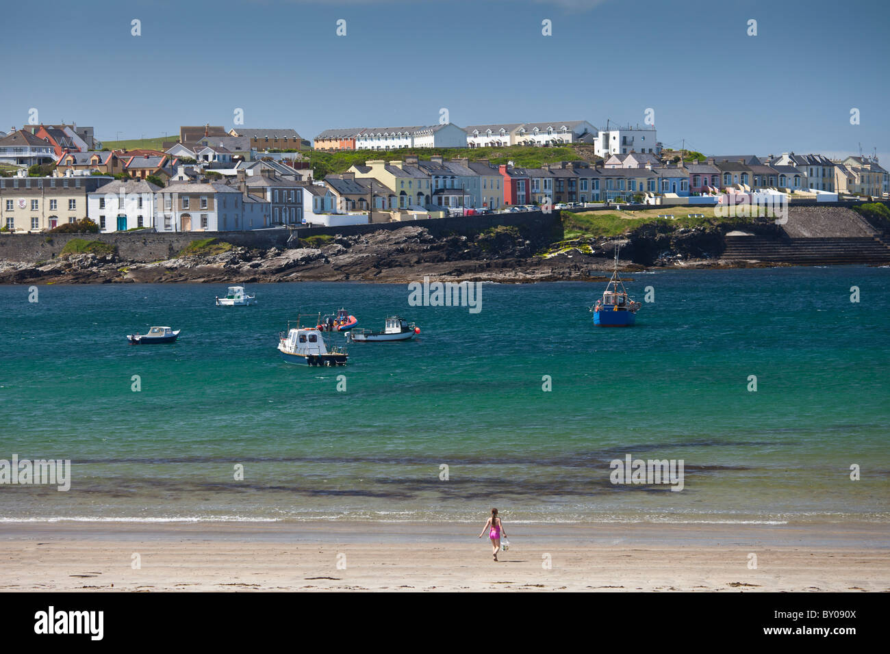 Ocean front houses and child playing on sandy beach at Kilkee County Clare, West Coast of Ireland - Stock Image