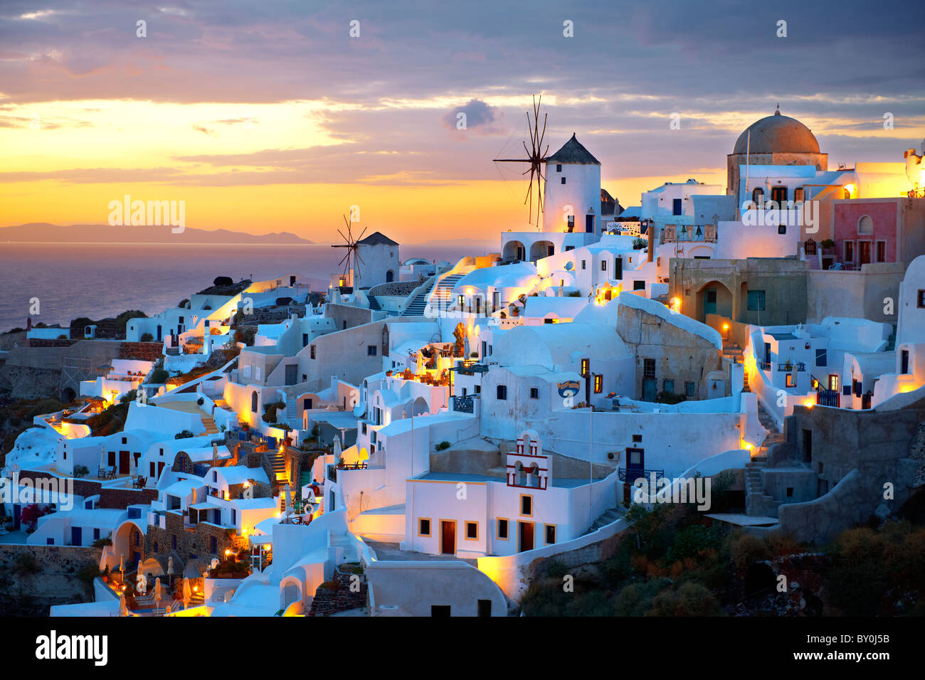 Oia ( Ia ) Santorini - Windmills and town at sunset, Greek Cyclades islands - Photos, pictures and images Stock Photo