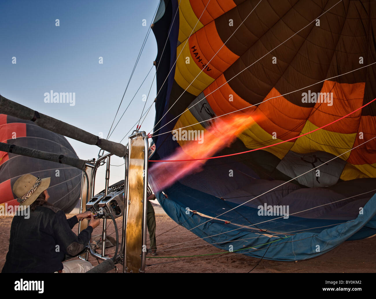 Pilot Astrid Gerhardt prepares this hot air balloon for take-off in Namib-Naukluft Park, Namibia. - Stock Image