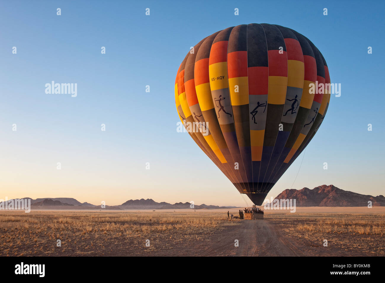 Hot air balloon ready for take-off at sunrise in Namib-Naukluft Park, central Namibia. - Stock Image