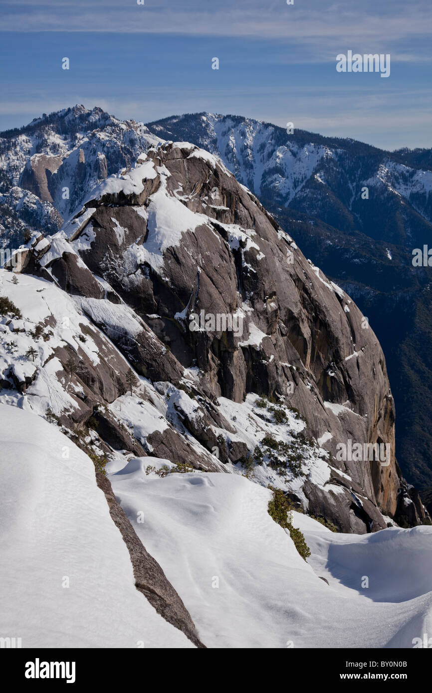 Great profile view of Moro Rock in the Sequoia National Park covered in snow on a bright day with a few clouds. - Stock Image