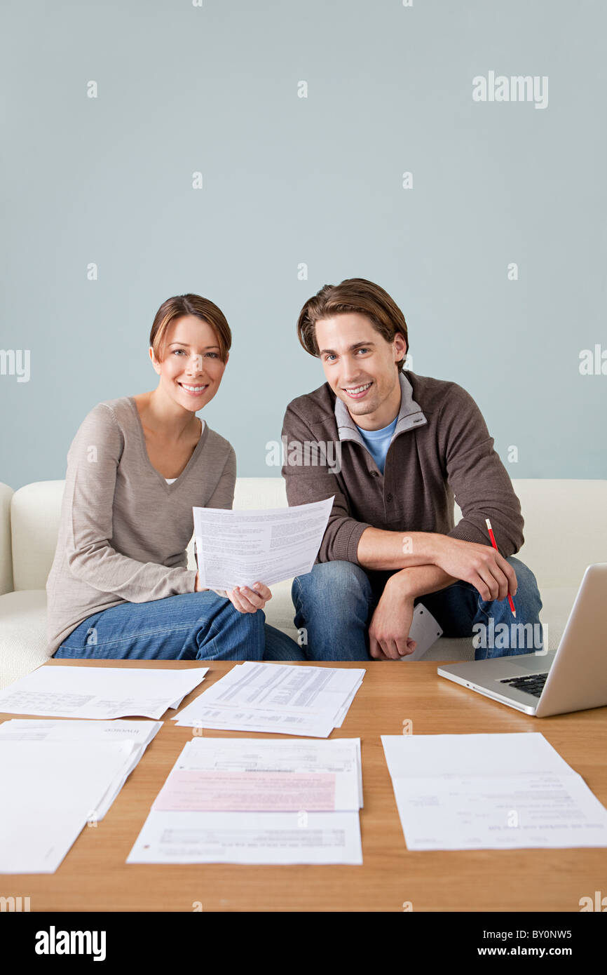 Young couple doing paperwork - Stock Image