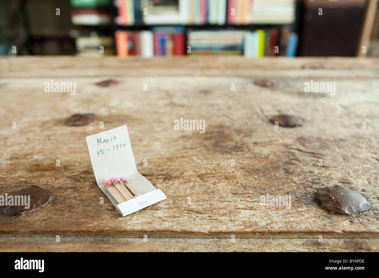 Phone number on a matchbook - Stock Image