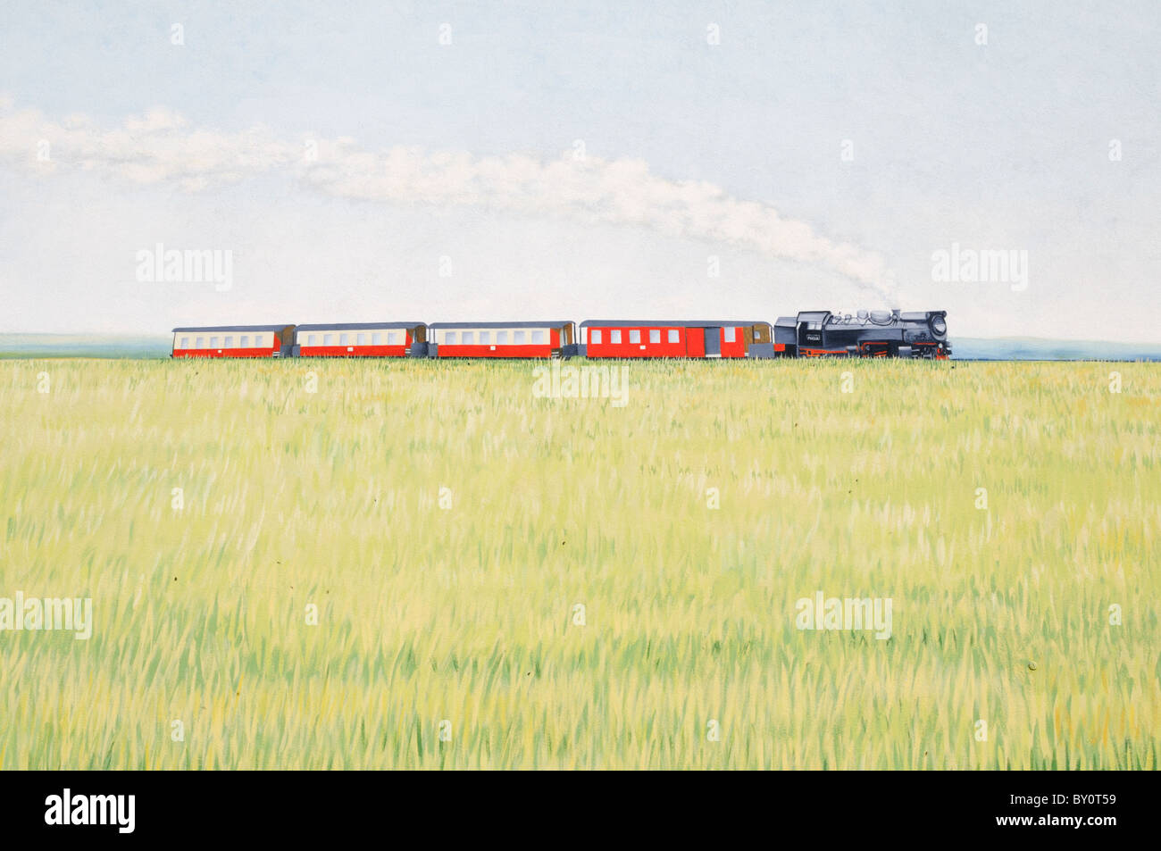 Wandmalerei an einer Hauswand; Motiv Dampflokomotive. - Mural painting on a house wall; motif steam locomotive. Stock Photo