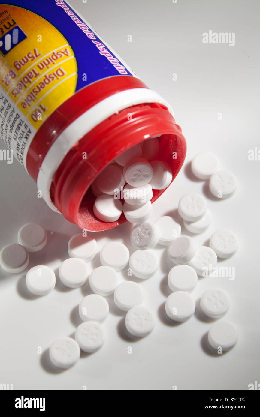 low dose 75g aspirin pills around open container - Stock Image