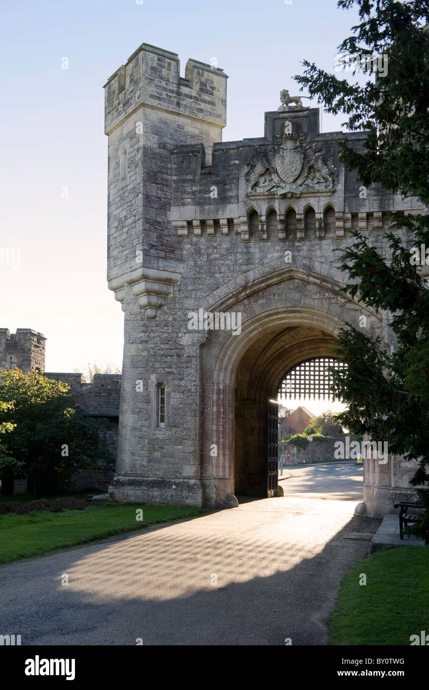Entrance/Exit gate to Arundel Castle and Gardens with afternoon light flooding through open portcullis.  West Sussex, - Stock Image