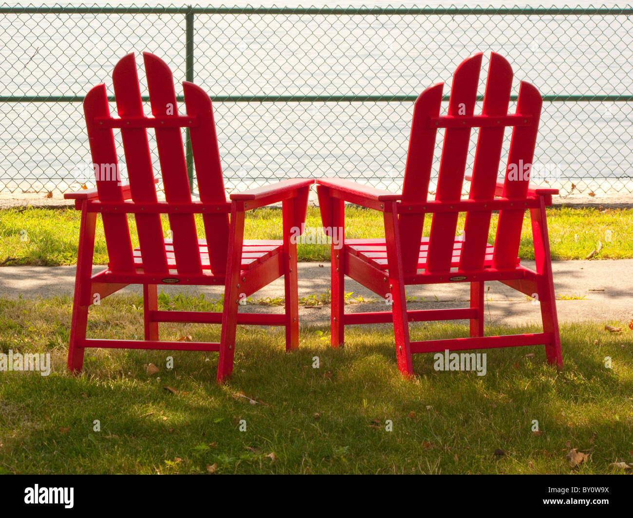 2 Red Adirondack Chairs   Stock Image