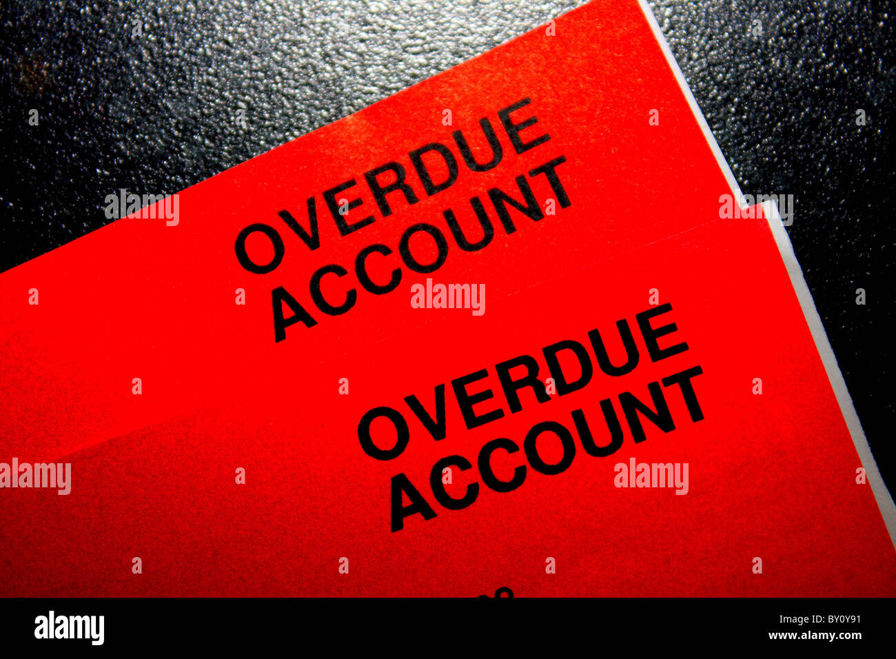 A red bill showing an overdue account in debt and in urgent need of payment - Stock Image