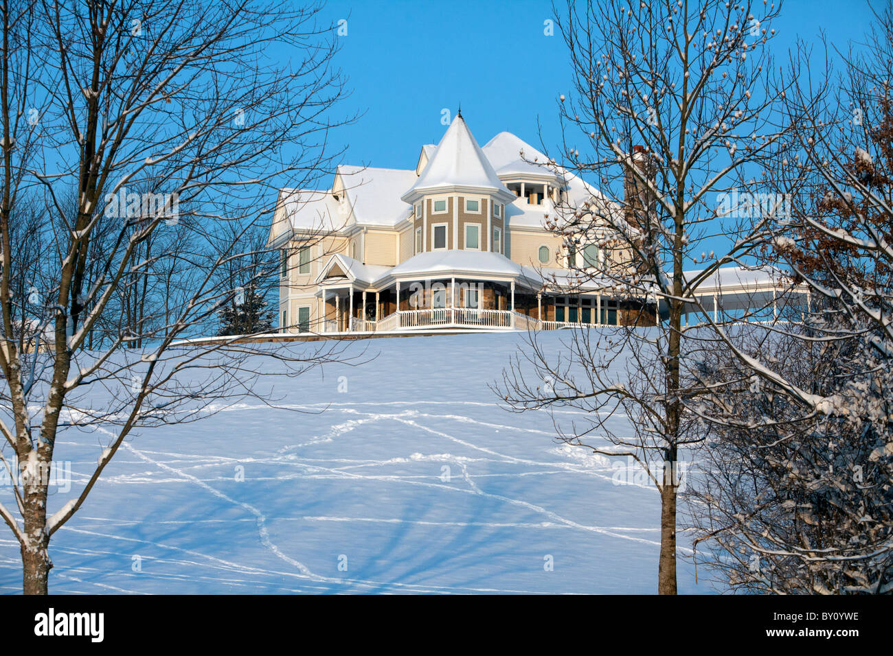 A Modern Victorian Style House On Snow Covered Hill