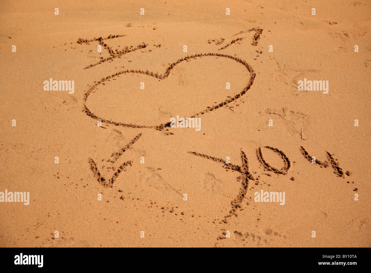 I love you written in the sand on the beach in Goa India - Stock Image