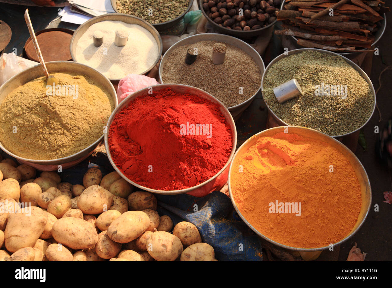 Bowls of cooking spices in Indian market Goa - Stock Image