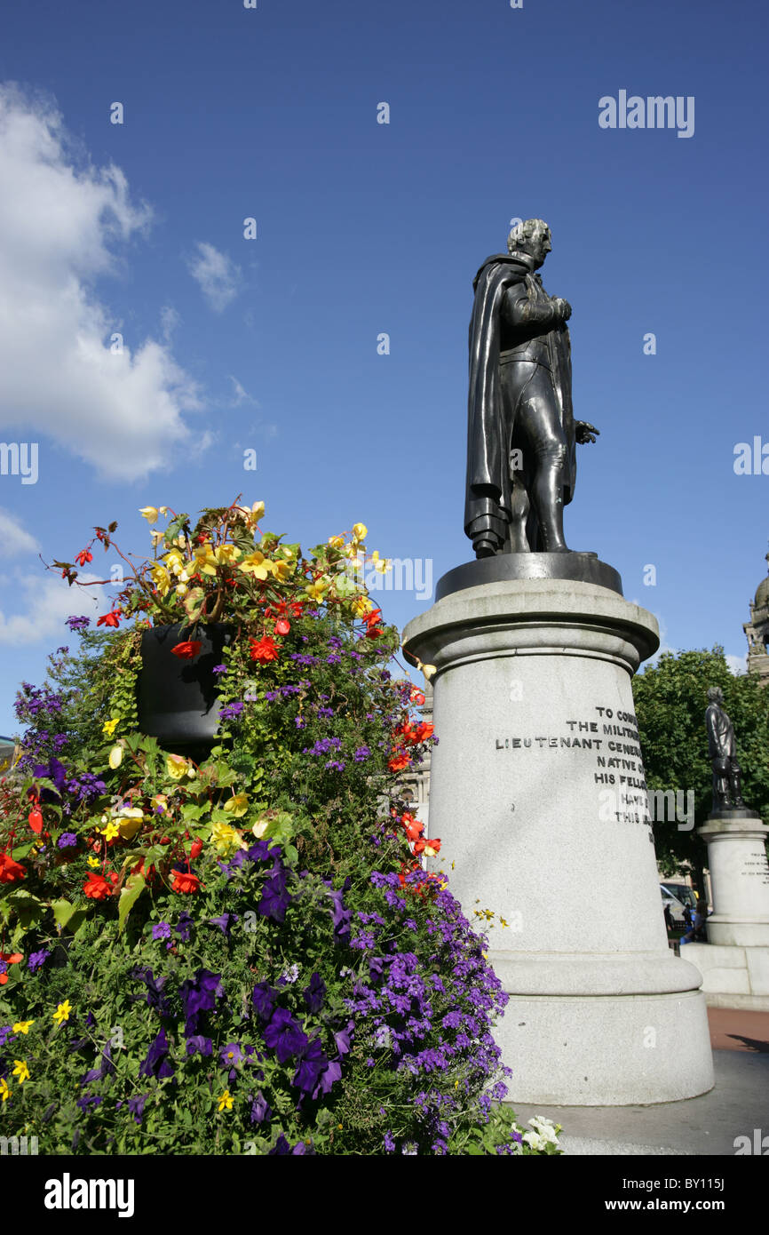 City of Glasgow, Scotland. Picturesque summer view of the General Sir John Moore statue at Glasgow's George Square. - Stock Image