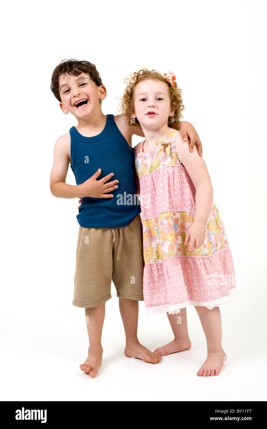 young boy and girl couple isolated on white - Stock Image