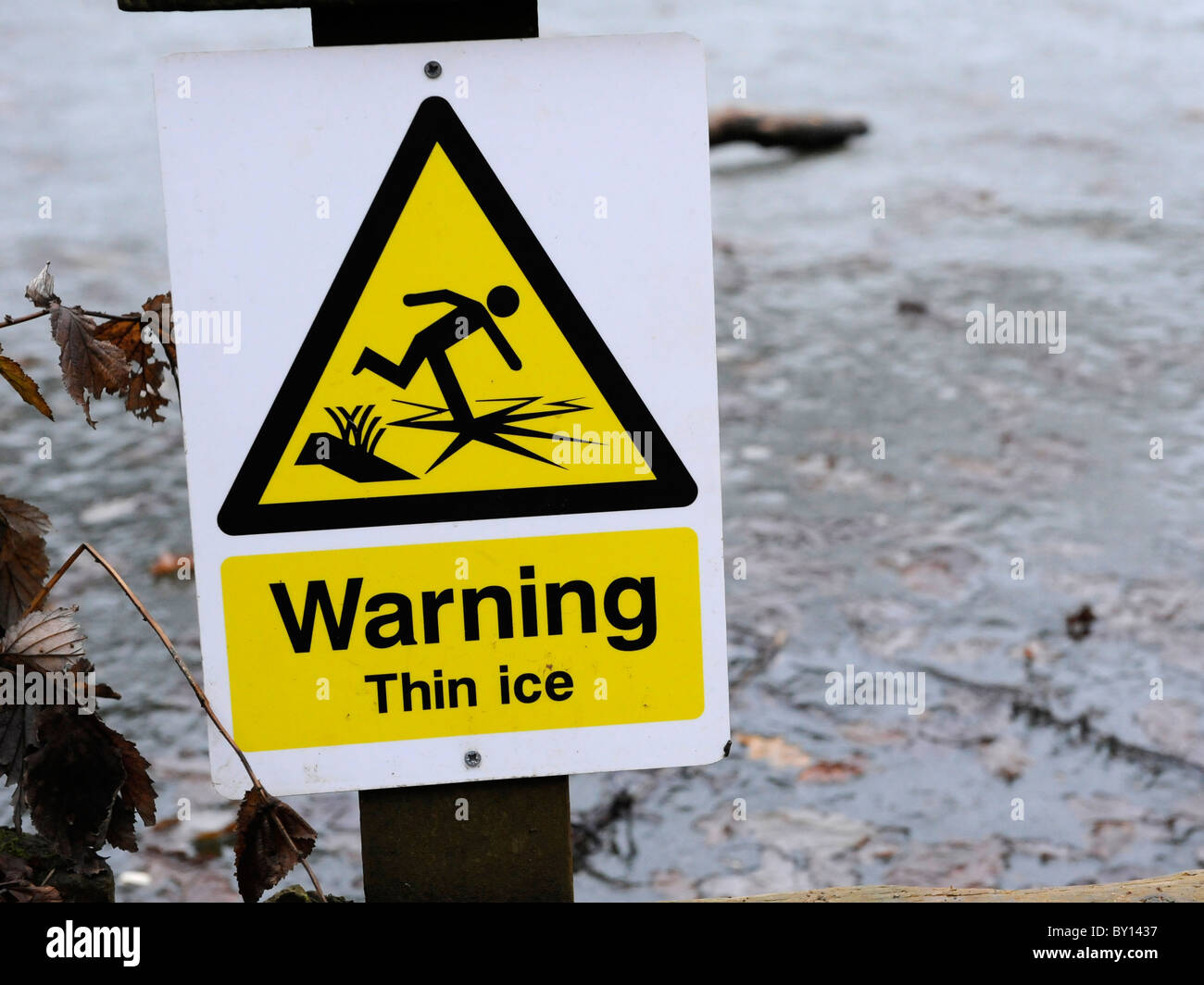 Warning sign that says Warning Thin Ice. - Stock Image