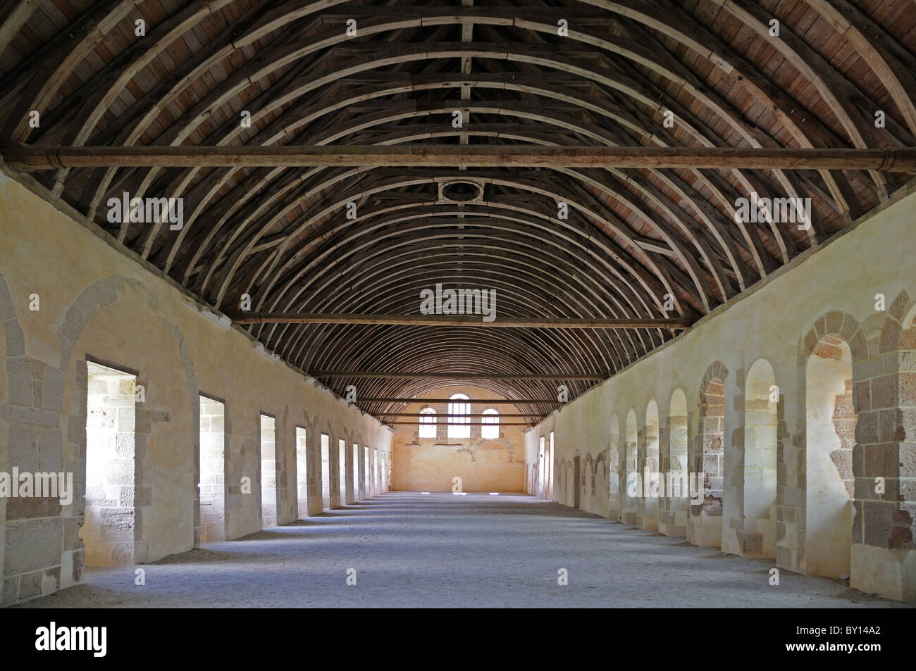 Interior of Dormitory showing barrel roof with ancient wooden beams in the Abbaye de Fontenay Burgundy France - Stock Image