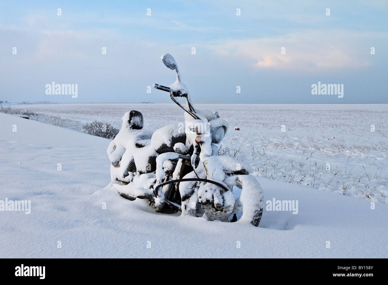 Snowy winter weather forces rider to abandoned Motorbike travel after Heavy Snowfall on the roads, 18th December, - Stock Image