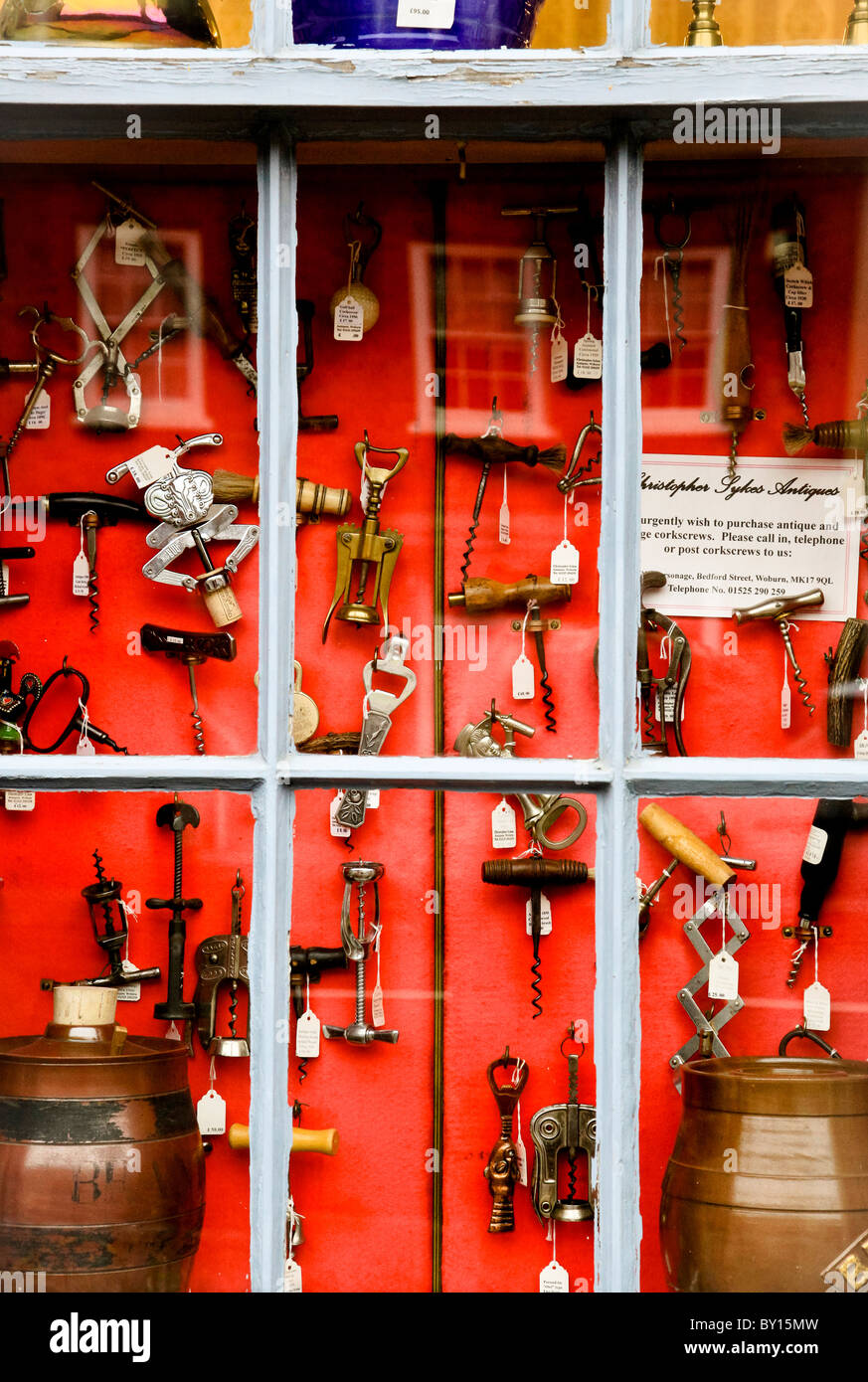 A shop store window with a display of old antique corkscrews - Stock Image
