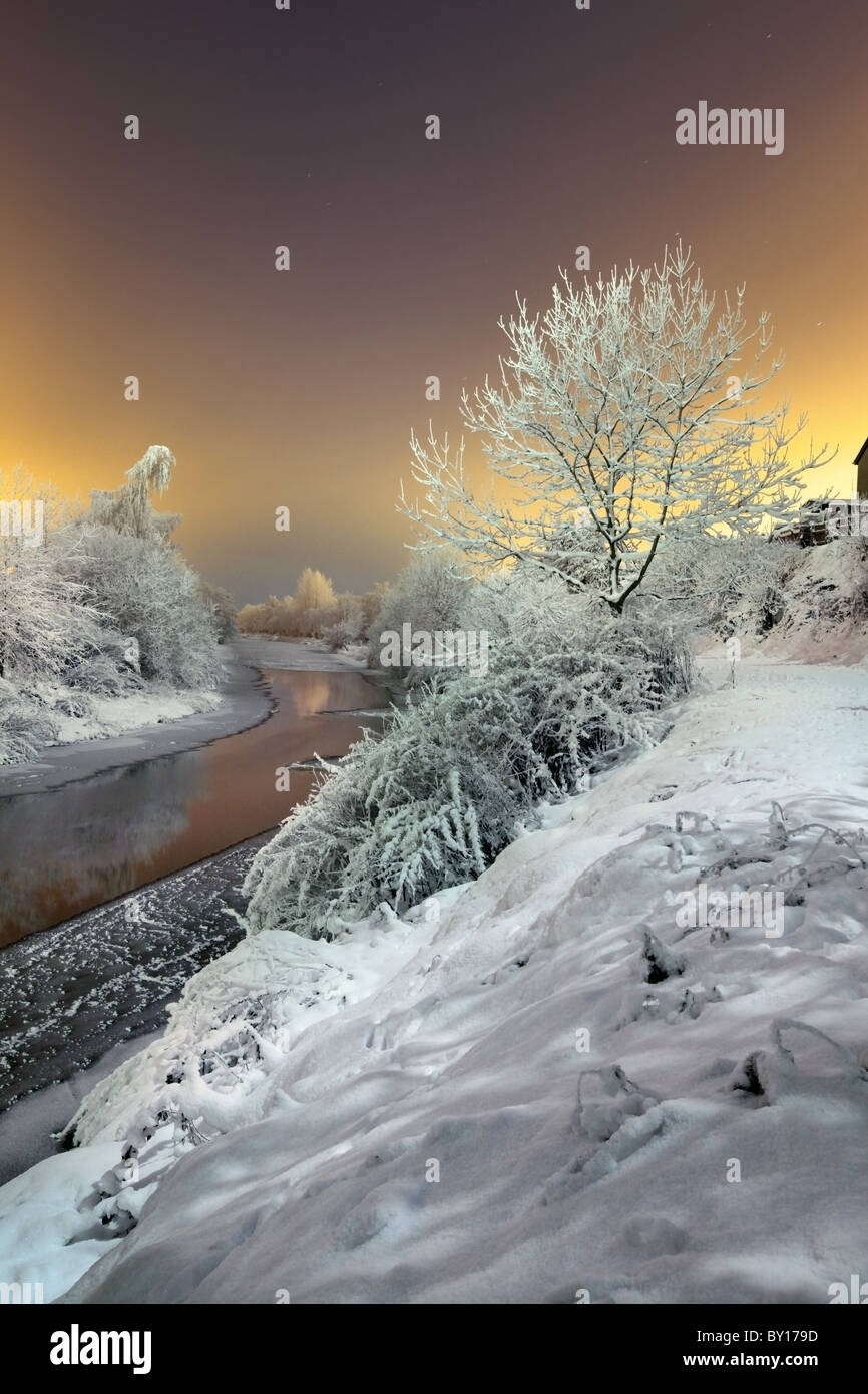 Heavy Snow fall at Lagan tawpath, captured under Full moon. - Stock Image