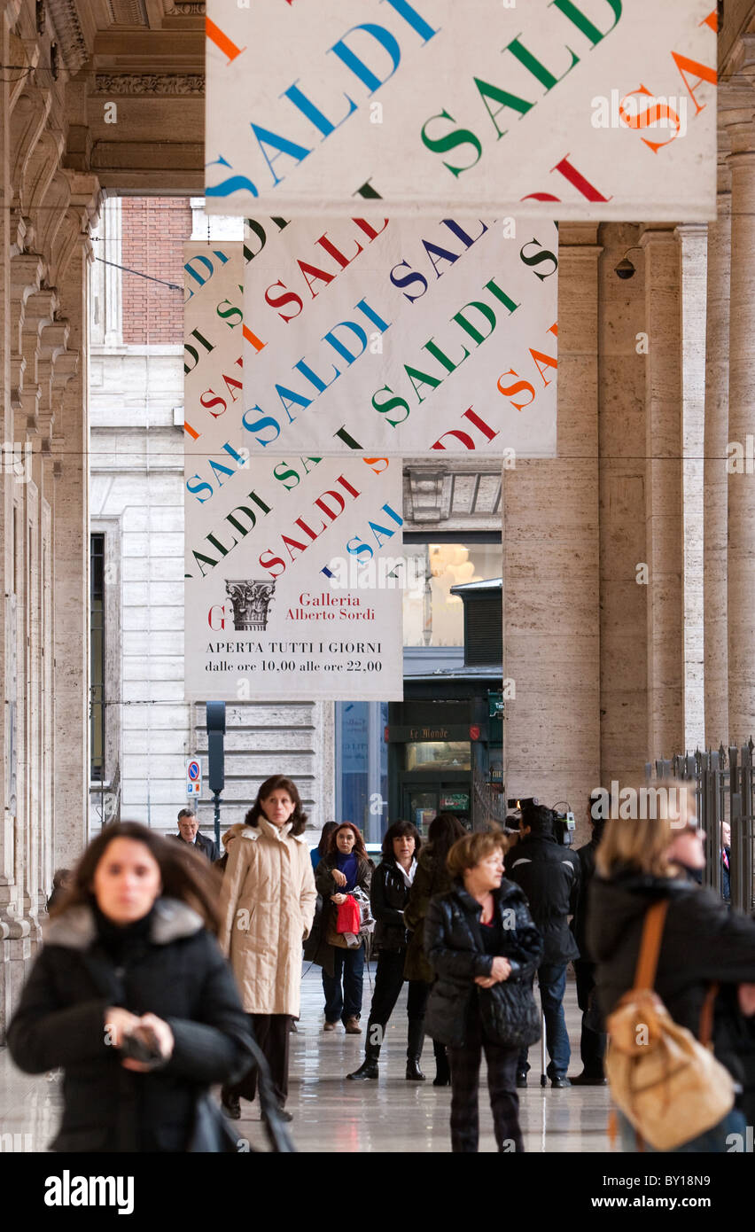 Wintry sales in January, discounts cartels in hight street center of Rome city Italy shopping Stock Photo