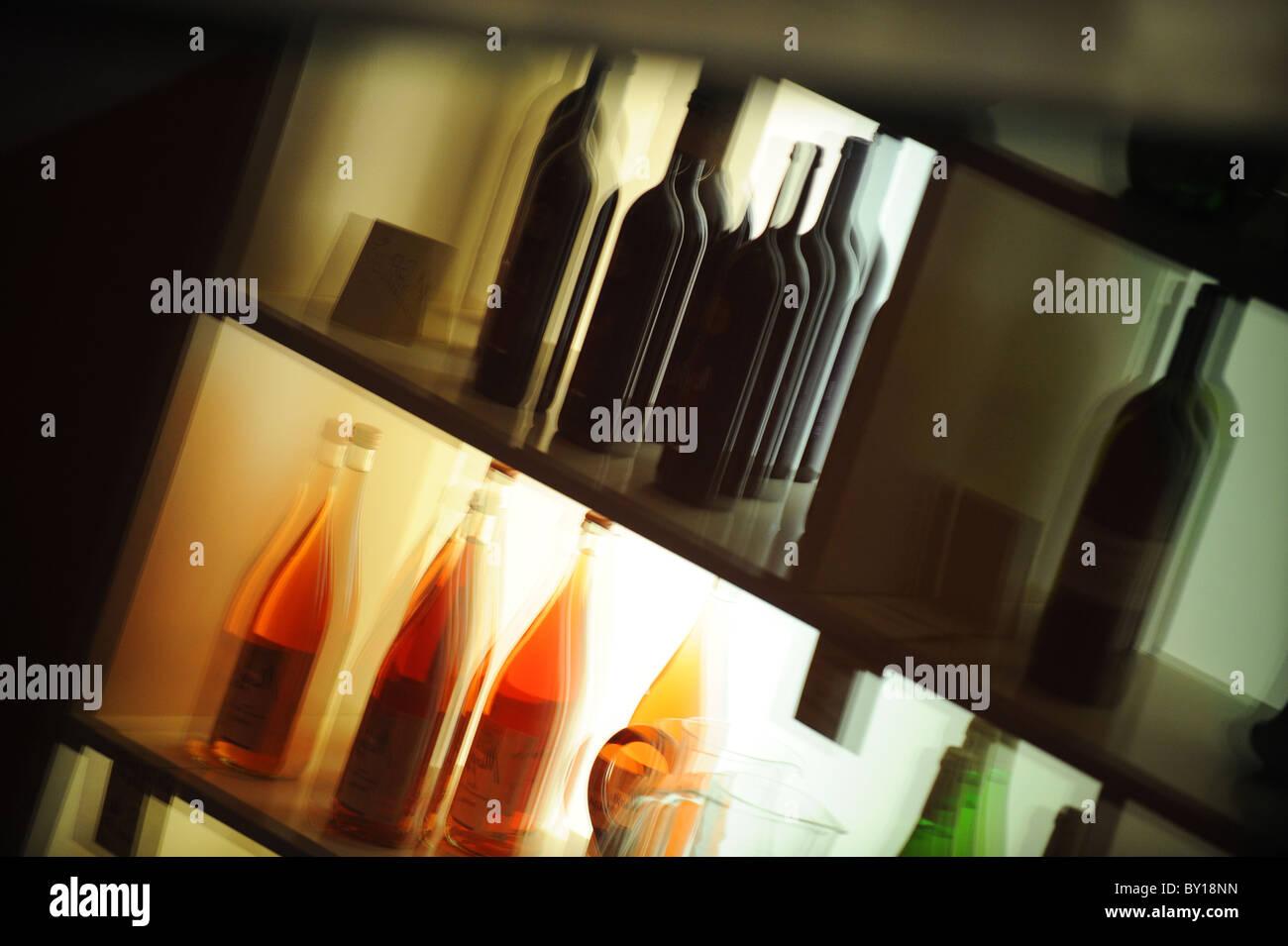 Bottles on a shelf - Stock Image