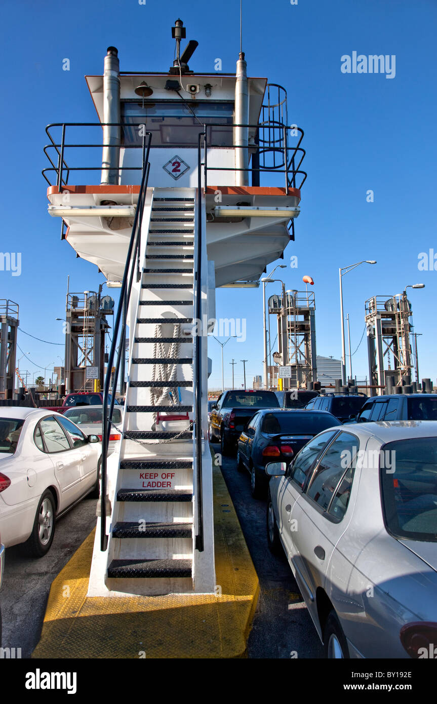 Port Aransas ferry carrying vehicles. - Stock Image