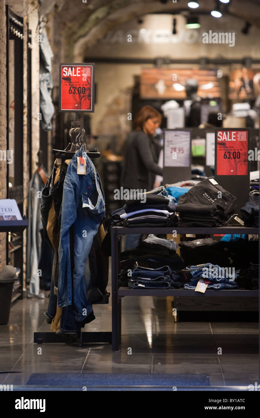 Wintry sales in January, discounts cartels display store in hight street in the center of Rome city Italy shopping Stock Photo
