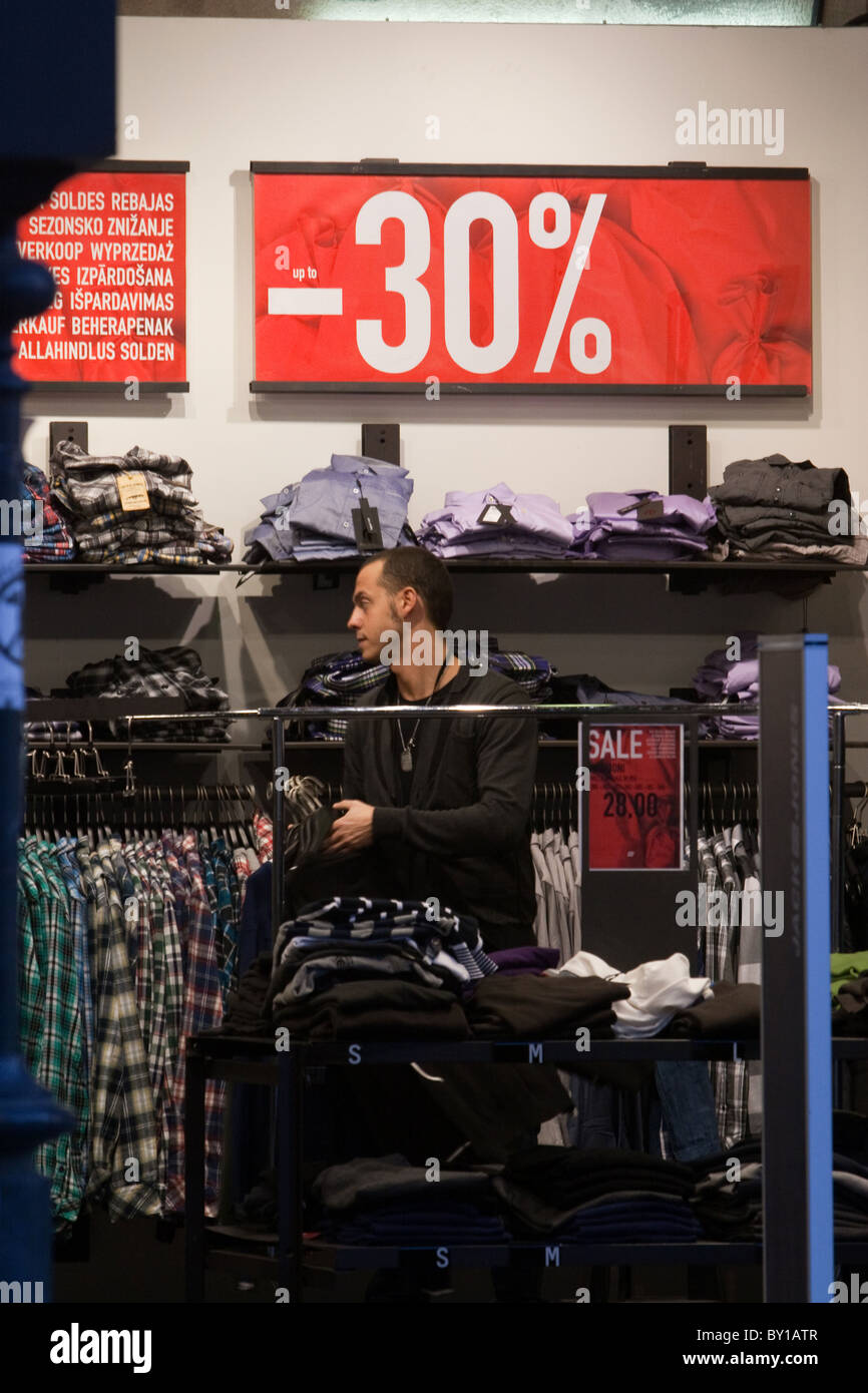 Wintry sales in January, discounts cartels on window store in hight street in the center of Rome city Italy shopping Stock Photo