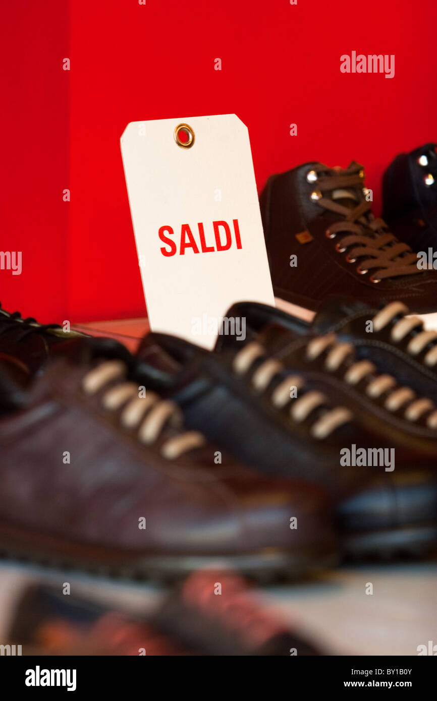 Wintry sales in January, sales discounts cartels displayed  store in hight street center of Rome city Italy shopping Stock Photo