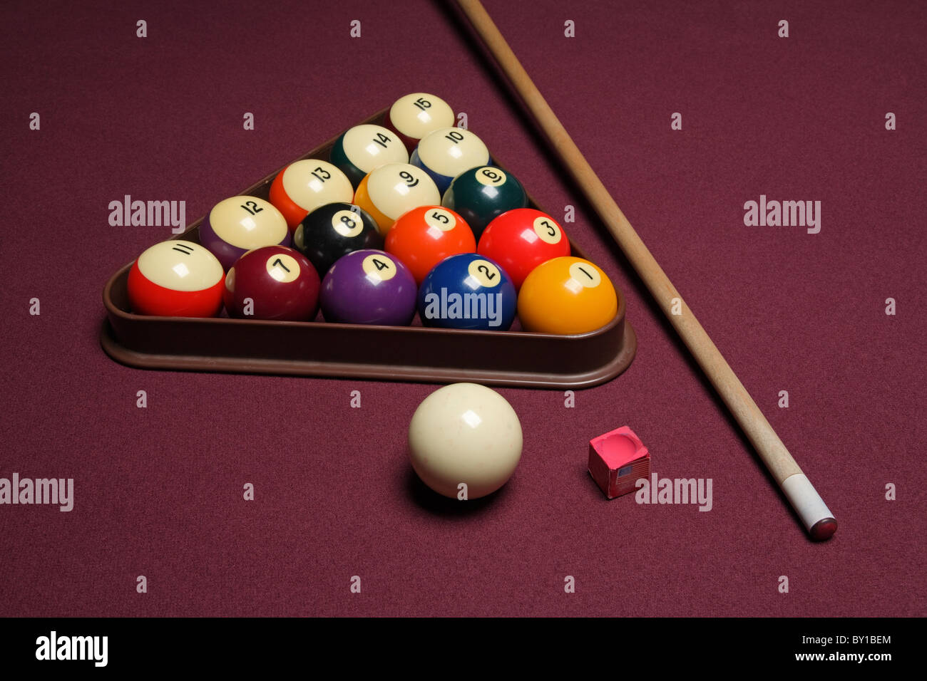 billiard pool table with cue stick triangle and balls - Stock Image