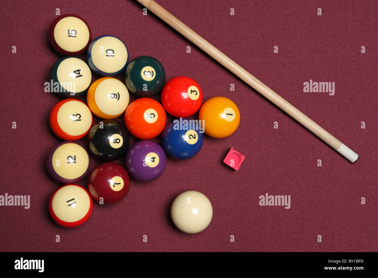 billiards pool table arrangement showing various game objects - Stock Image