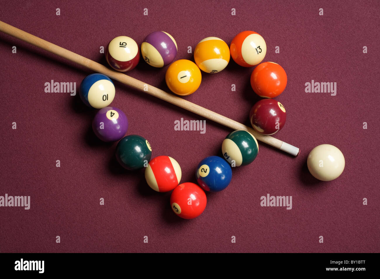 heart-shaped billiard balls with cue ball and stick - Stock Image