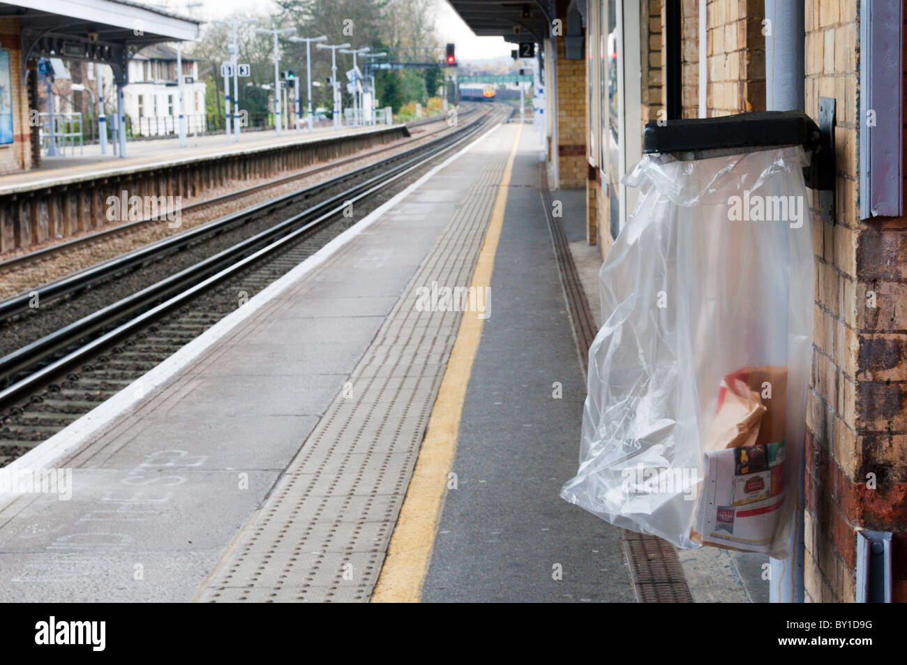 A see-through transparent bin-bag used as a security measure on a south London station. - Stock Image